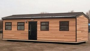 Modular building with pitched roof and timber cladding